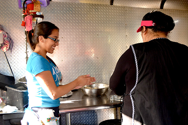 Cooking at Taqueria Aztlan of Redland Market Village